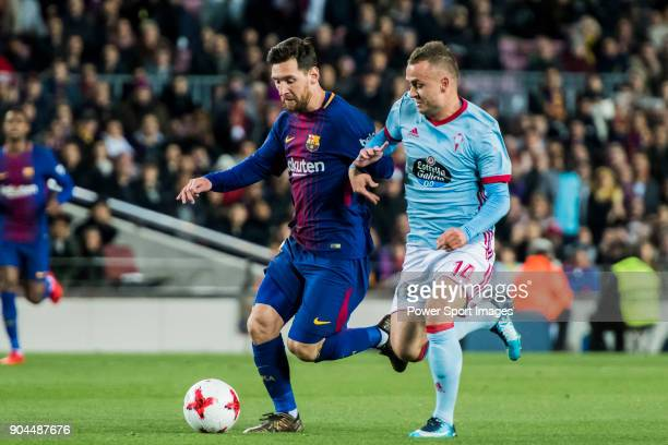 Lionel Andres Messi of FC Barcelona fights for the ball with Stanislav Lobotka of RC Celta de Vigo during the Copa Del Rey 201718 Round of 16 match...