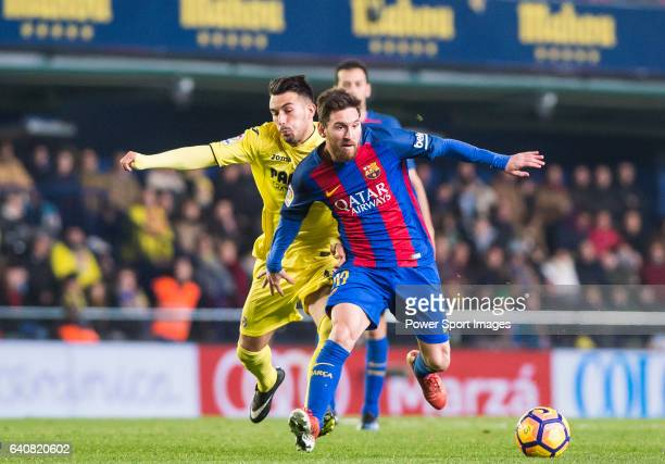 Lionel Andres Messi of FC Barcelona fights for the ball with Nicola Sansone of Villarreal CF during their La Liga match between Villarreal CF and FC...