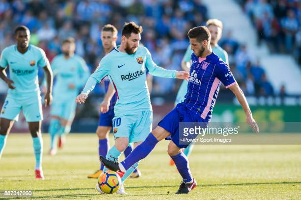 Lionel Andres Messi of FC Barcelona fights for the ball with Ruben Salvador Perez del Marmol of CD Leganes during the La Liga 201718 match between CD...