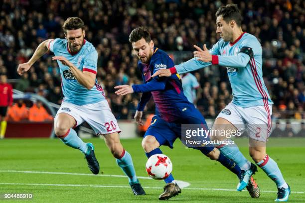 Lionel Andres Messi of FC Barcelona fights for the ball with Sergi Gomez Sola and Hugo Mallo Novegil of RC Celta de Vigo during the Copa Del Rey...