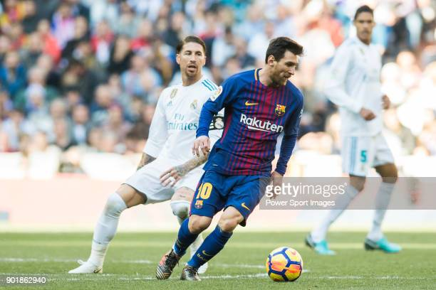 Lionel Andres Messi of FC Barcelona fights for the ball with Sergio Ramos of Real Madrid during the La Liga 201718 match between Real Madrid and FC...