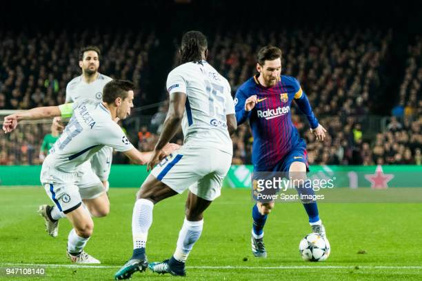 Lionel Andres Messi of FC Barcelona fights for the ball with Victor Moses and Cesar Azpillicueta of Chelsea FC during the UEFA Champions League...