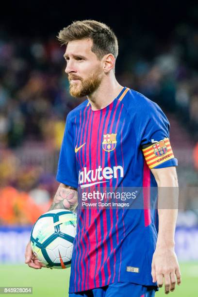 Lionel Andres Messi of FC Barcelona holds the ball after winning the La Liga match between FC Barcelona vs RCD Espanyol at the Camp Nou on 09...