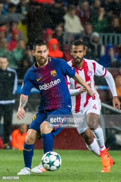 Lionel Andres Messi of FC Barcelona is followed by Alaixys Romao of Olympiacos FC during the UEFA Champions League 201718 match between FC Barcelona...