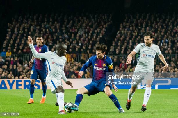 Lionel Andres Messi of FC Barcelona is tackled by N'Golo Kante and Cesc Fabregas of Chelsea FC during the UEFA Champions League 201718 Round of 16...