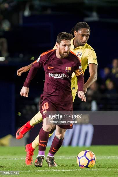 Lionel Andres Messi of FC Barcelona is tackled by Ruben Afonso Borges Semedo of Villarreal CF during the La Liga 201718 match between Villarreal CF...