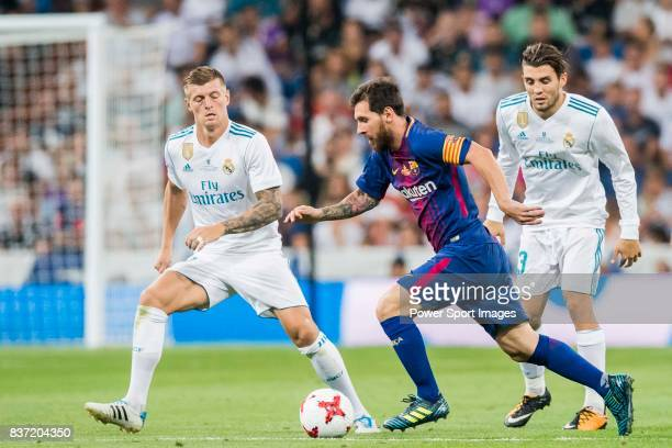 MADRID SPAIN AUGUST 16 Lionel Andres Messi of FC Barcelona is tackled by Toni Kroos of Real Madrid during their Supercopa de Espana Final 2nd Leg...