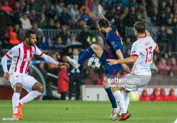 Lionel Andres Messi of FC Barcelona is tackled by with Guillaume Gillet of Olympiacos FC during the UEFA Champions League 2017-18 match between FC...
