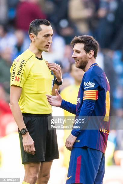 Lionel Andres Messi of FC Barcelona speaks with referee Jose Maria Sanchez Martinez during the La Liga 201718 match between Real Madrid and FC...