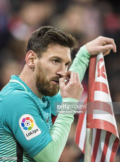 Lionel Andres Messi of FC Barcelona stands past a corner flag during their Copa del Rey Round of 16 first leg match between Athletic Club and FC...