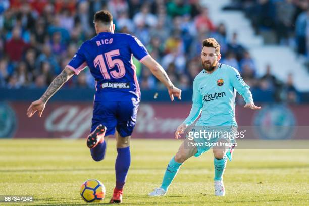 Lionel Andres Messi of FC Barcelona tackles Diego Rico Salguero of CD Leganes during the La Liga 201718 match between CD Leganes vs FC Barcelona at...