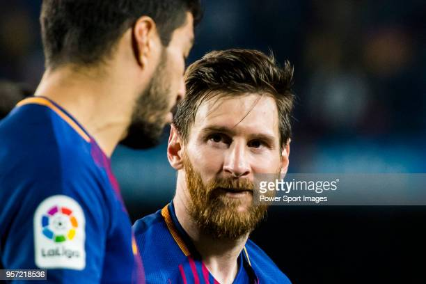 Lionel Andres Messi of FC Barcelona talks to teammate Luis Alberto Suarez Diaz after the La Liga match between Barcelona and Real Madrid at Camp Nou...