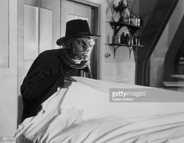 Lionel Atwill plays disfigured sculptor Ivan Igor in 'The Mystery of the Wax Museum' a Warner Brothers film directed by Michael Curtiz