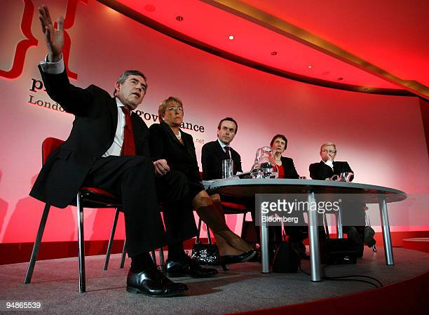 Lionel Barber an editor with the Financial Times center participates in a roundtable discussion with Prime Ministers from left Gordon Brown of the UK...