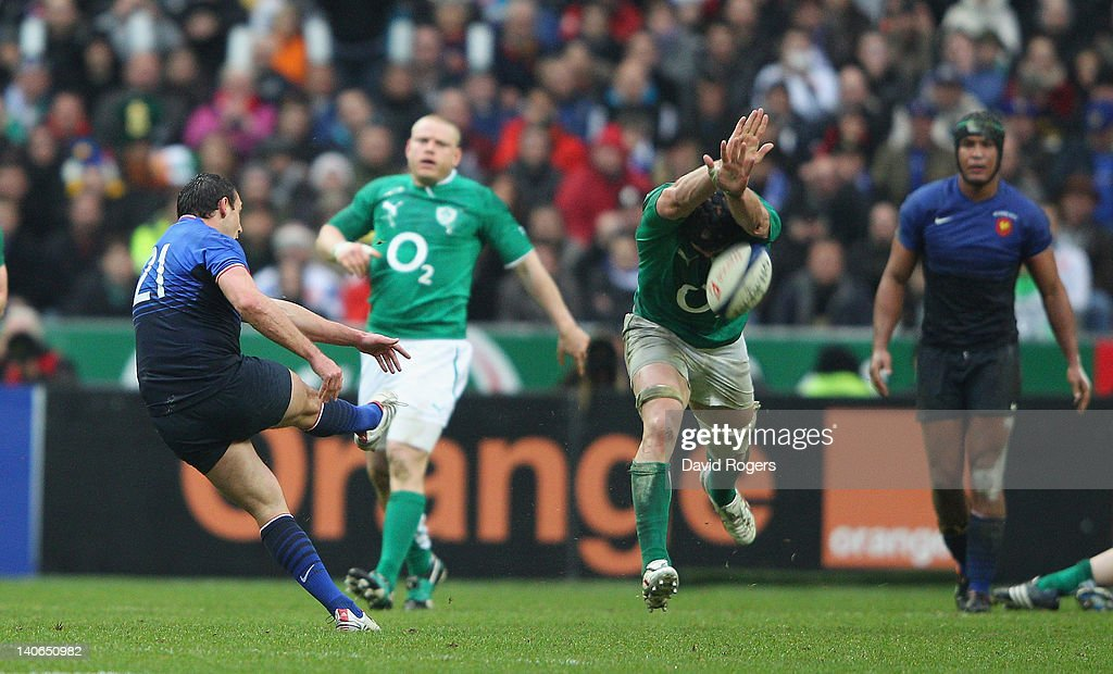 Lionel Beauxis of France has his last minute match winning drop goal attempt blocked by Stephen Ferris during the RBS Six Nations match between France and Ireland at Stade de France on March 4, 2012 in Paris, France.