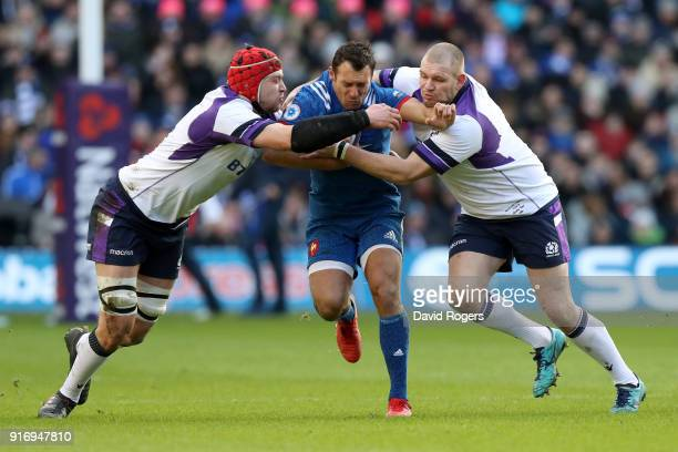 Lionel Beauxis of France is tackled by Grant Gilchrist of Scotland and Gordon Reid of Scotland during the NatWest Six Nations match between Scotland...