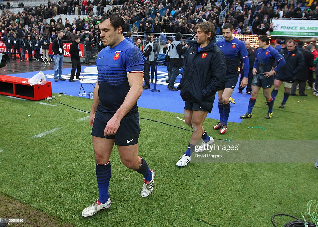 Lionel Beauxis (L) of France, who missed a last minute match winning drop goal looks dejected during the RBS Six Nations match between France and Ireland at Stade de France on March 4, 2012 in Paris, France.