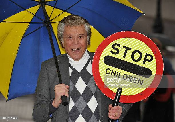 Lionel Blair dresses up as a lollipop man in aid of Age UK at Southbank Centre on January 6 2011 in London England