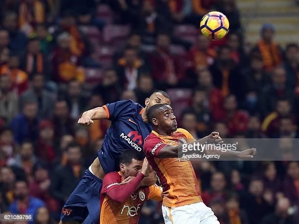 Lionel Carol and Sinan Gumus of Galatasaray in action against Yalcin Ayhan of Medipol Basaksehir during the Turkish Spor Toto Super League soccer...
