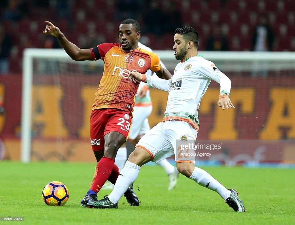 Lionel Carole (L) of Galatasaray in action against Daniel Candeias (23) of Aytemiz Alanyaspor during the Turkish Spor Toto Super Lig football match between Galatasaray and Aytemiz Alanyaspor at TT Arena in Istanbul, Turkey on December 25, 2016.