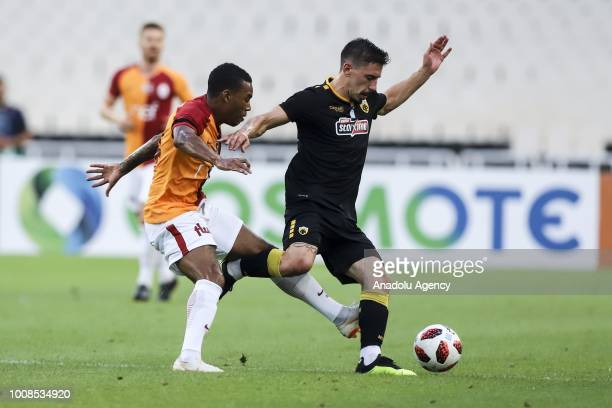 Lionel Carole of Galatasaray in action with Andre Simoes of AEK Athens during friendly football game between AEK Athens and Galatasaray in OAKA...