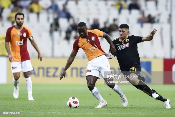 Lionel Carole of Galatasaray in action with Tasos Bakasetas of AEK Athens during friendly football game between AEK Athens and Galatasaray in OAKA...