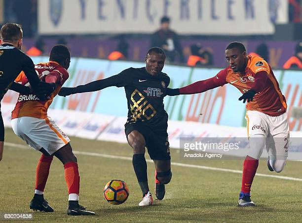 Lionel Carole of Galatasaray is in action against Aminu Umar of Osmanlispor during the Turkish Spor Toto Super Lig football match between Osmanlispor...