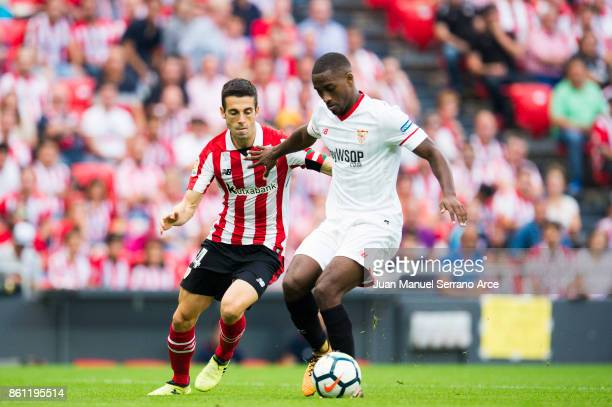 Lionel Carole of Sevilla FC competes for the ball with Markel Susaeta of Athletic Club during the La Liga match between Athletic Club Bilbao and...
