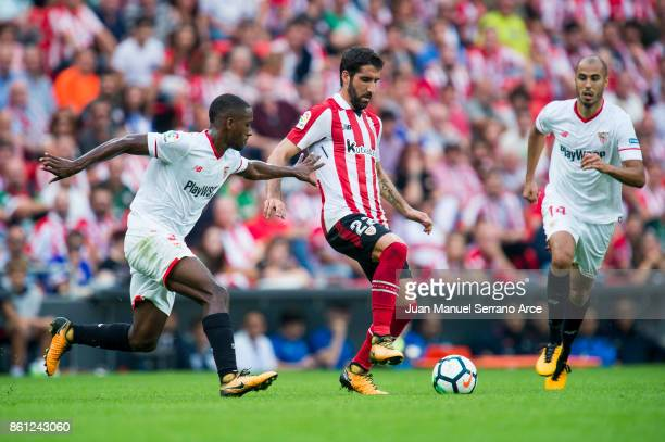 Lionel Carole of Sevilla FC competes for the ball with Raul Garcia of Athletic Club during the La Liga match between Athletic Club Bilbao and Sevilla...