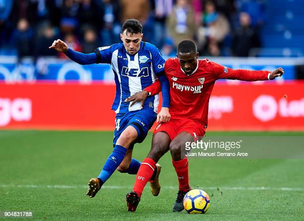 Lionel Carole of Sevilla FC duels for the ball with Munir El Haddadi of Deportivo Alaves during the La Liga match between Deportivo Alaves and...