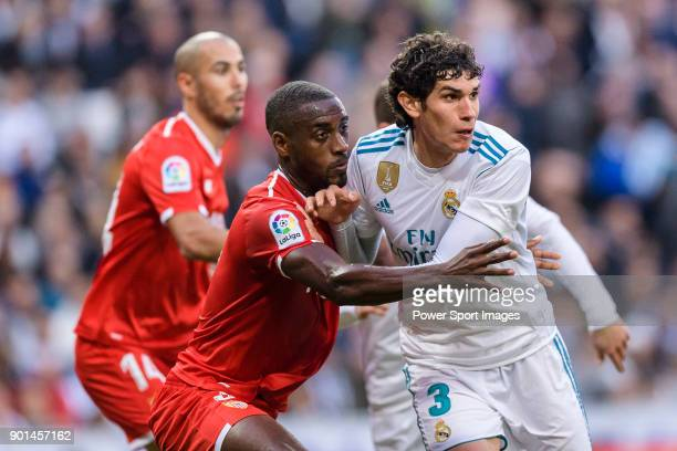 Lionel Carole of Sevilla FC fights for position with Jesus Vallejo of Real Madrid during La Liga 201718 match between Real Madrid and Sevilla FC at...