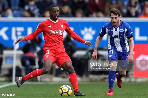 Lionel Carole of Sevilla FC Ibai Gomez of Deportivo Alaves during the La Liga Santander match between Deportivo Alaves v Sevilla at the Estadio de...
