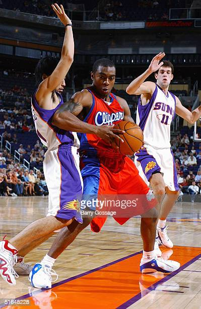 Lionel Chalmers of the Los Angeles Clippers backs into Yuta Tabuse of the Phoenix Suns on October 13 2004 at America West Arena in Phoenix Arizona...