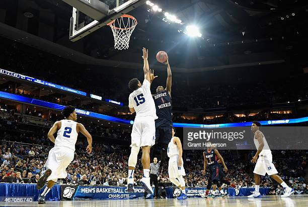 Lionel Gomis of the Robert Morris Colonials shoots over Jahlil Okafor of the Duke Blue Devils during the second round of the 2015 NCAA Men's...