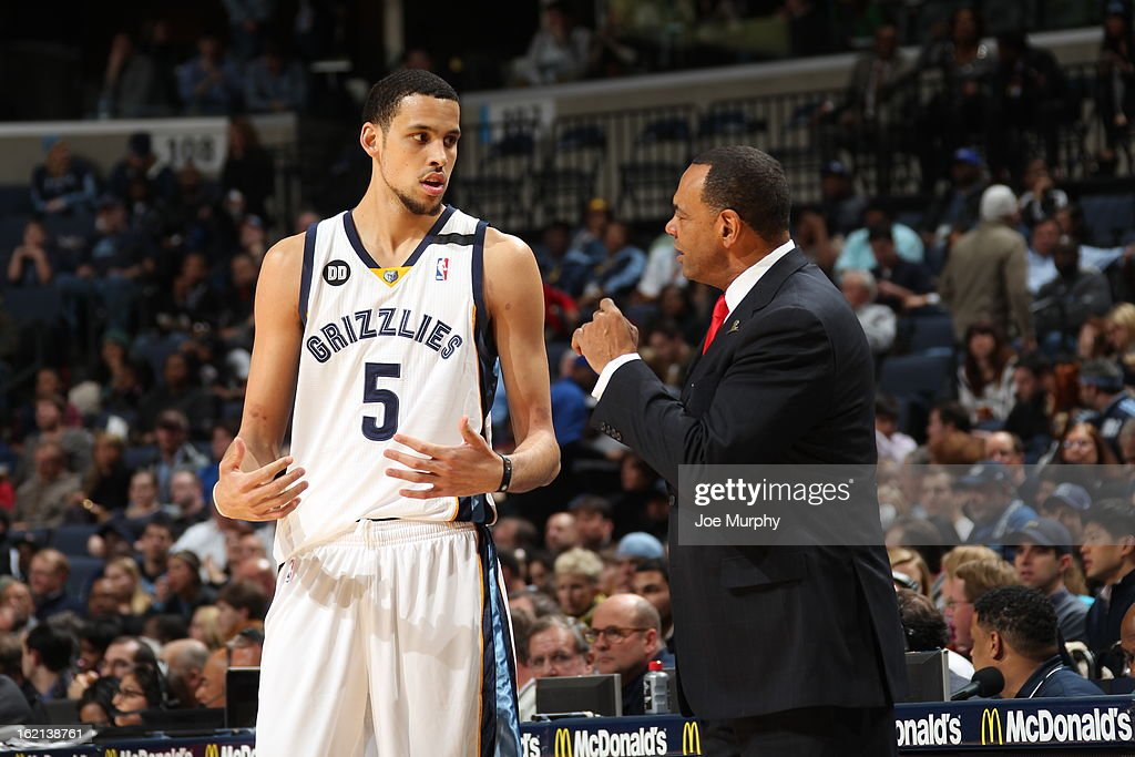 Lionel Hollins and Austin Daye #5 of the Memphis Grizzlies discuss a play against the Washington Wizards on February 1, 2013 at FedExForum in Memphis, Tennessee.