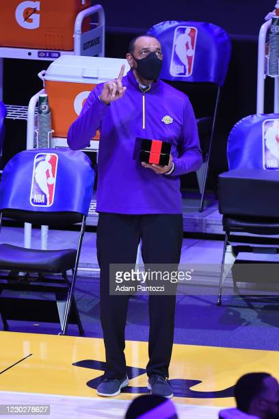 Lionel Hollins of the Los Angeles Lakers reacts as he gets his 2019-20 NBA Championship ring during the ring ceremony before the game against the LA...