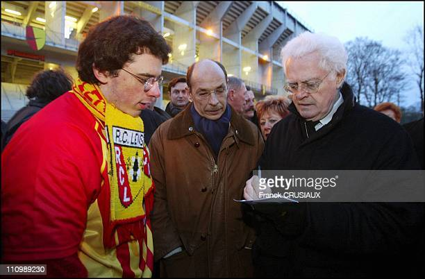 Lionel Jospin and Bernard Roman in Lens France on February 28 2004