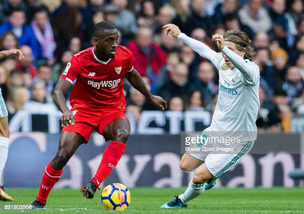 Lionel Jules Carole of Sevilla FC fights for the ball with Luka Modric of Real Madrid during the La Liga 201718 match between Real Madrid and Sevilla...