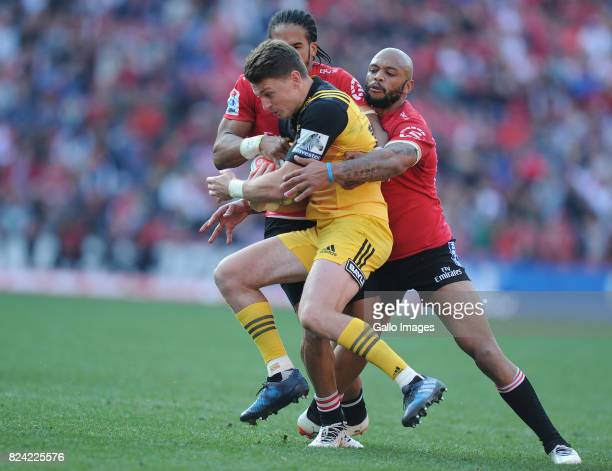 Lionel Mapoe and Courtnall Skosan of Lions in action with Beauden Barrett of Hurricanes during the Super Rugby Semi Final match between Emirates...