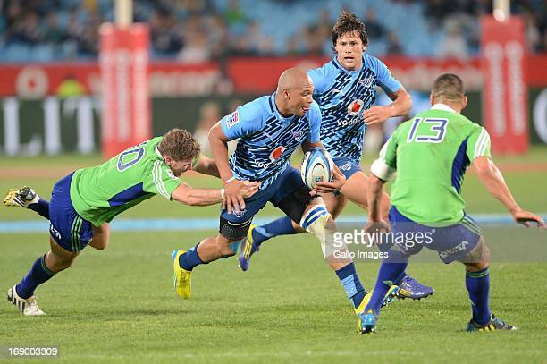 Lionel Mapoe of Bull tackled by Colin Slade of Highlanders during the Super Rugby match between Vodacom Bulls and Highlanders from Loftus Versfeld on...