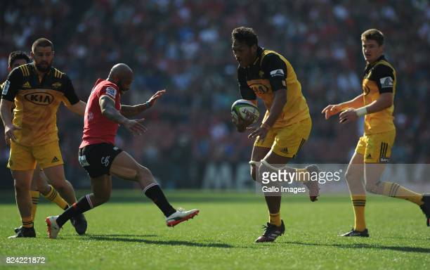 Lionel Mapoe of Lions in action with Sam Lousi of Hurricanes during the Super Rugby Semi Final match between Emirates Lions and Hurricanes at...