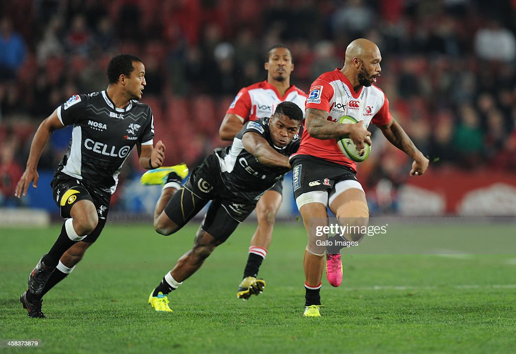 Lionel Mapoe of Lions is tackled by Sibusiso Sithole of Sharks during the Super Rugby match between Emirates Lions and Cell C Sharks at Emirates Airline Park on July 02, 2016 in Johannesburg, South Africa.