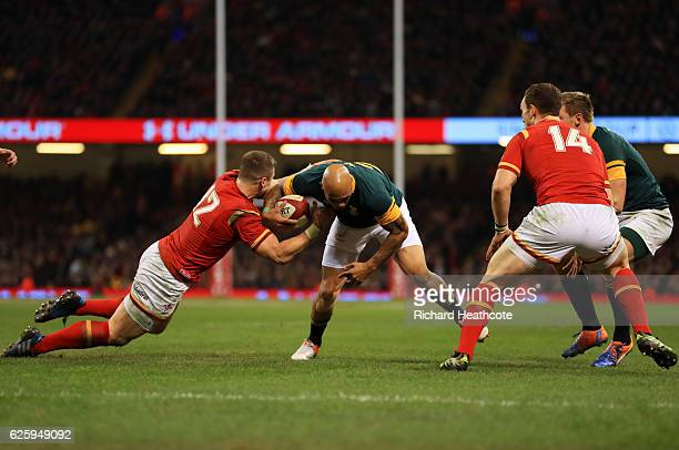 Lionel Mapoe of South Africa is tackled by Scott Williams of Wales during the international match between Wales and South Africa at Principality...