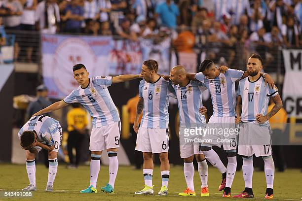 Lionel Messi #10 of Argentina with team mates on the half way line after missing a penalty in the penalty shoot out during the Argentina Vs Chile...
