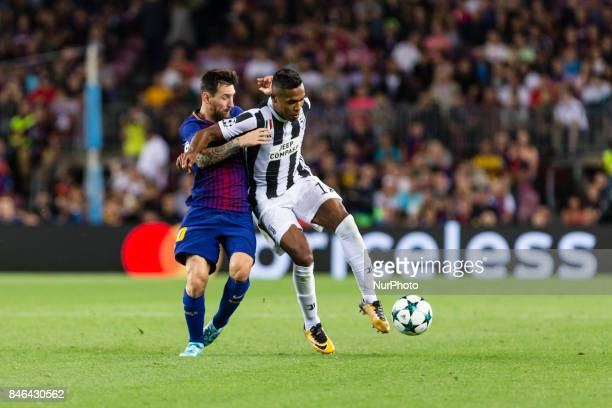 Lionel Messi and Alex Sandro during the match between FC Barcelona Juventus for the group stage round 1 of the Champions League held at Camp Nou...