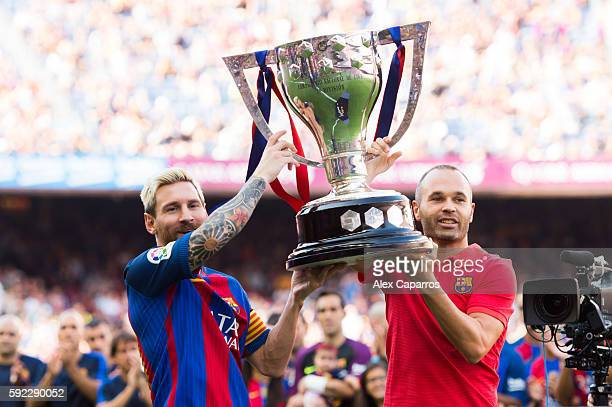 Lionel Messi and Andres Iniesta of FC Barcelona lift up the Spanish La Liga 20152016 season trophy before the La Liga match between FC Barcelona and...