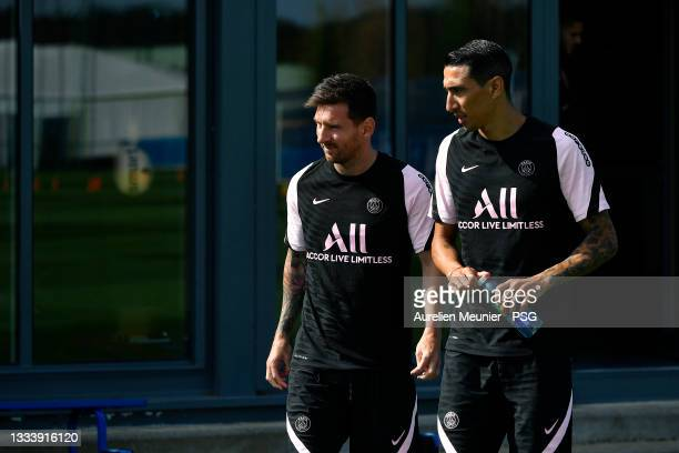 Lionel Messi and Angel Di Maria arrive to a Paris Saint-Germain training session at Ooredoo Center on August 13, 2021 in Paris, France.