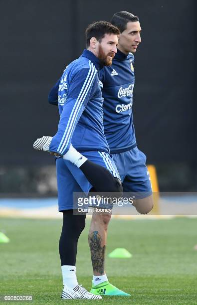 Lionel Messi and Angel Di Maria of Argentin stretch during an Argentina Training Session at City Football Academy on June 6 2017 in Melbourne...