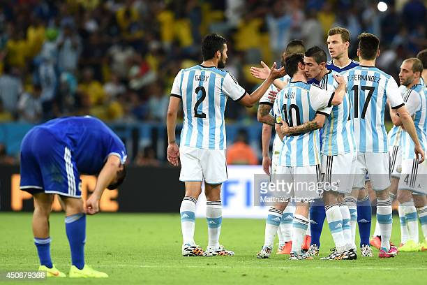 Lionel Messi and Angel di Maria of Argentina celebrate after defeating Bosnia and Herzegovina 21 Argentina players celebrate the 21 victory after the...