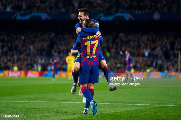 Lionel Messi and Antoine Griezmann of FC Barcelona celebrating their team's third goal during the UEFA Champions League group F match between FC...